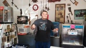 Ronda's son Kyle holding packages of his fresh made jerky.