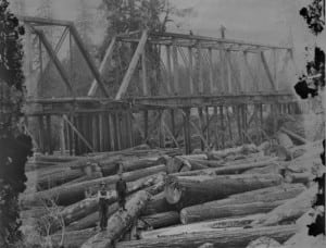 Logs pile up along the Humptulips River Railroad Bridge. Photo courtesy of Aberdeen Museum of History.