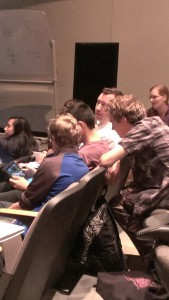 David Quigg chats with his fellow cast members before rehearsal.