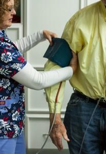Nurse checks patient's blood pressure at Grays Harbor Community Hospital.