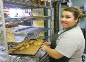 Yanela Castenada of Nancy's Bakery tends to  a batch of biscotti.