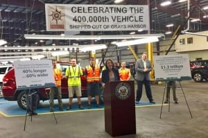 US Senator Maria Cantwell discusses importance of freight mobility and the need for national multimodal freight policy as outlined in the DRIVE Act at Pasha's auto processing warehouse at Port of Grays Harbor.