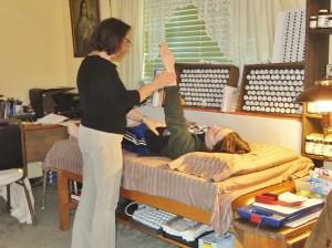 Jane Reibel demonstrates muscle testing.