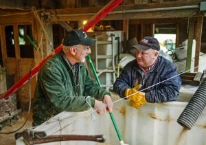 Elma farmer Jay Gordon chats with longtime friend Neal Lucht, 55, in the farm's grainery recently after the pair enjoyed homemade sourdough bread for breakfast. Lucht, who lives in Molalla, Ore., was visiting Gordon to obtain some grain to bring back home.
