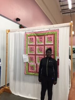 Tiani with quilt