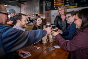 City of Aberdeen Brewing Group with beer at Steam Donkey