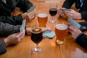 City of Aberdeen Brewing People playing cards at Mount Olympus Brewing