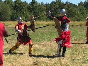 zach miller in armor fighting in field