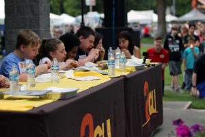South Sound BBQ Festival kids participating in BBQ Festival chicken wing eating contest