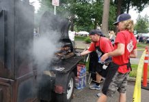 South Sound BBQ Festival workers preparing BBQ on grill at BBQ Festival