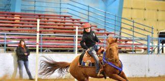 Annie Burnett on horseback at an event
