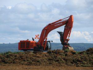 Bowerman Airport Excavator Removing Grass Sod