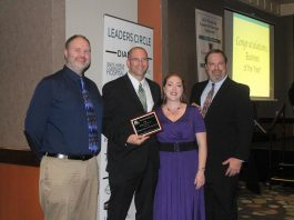 Ocean Spray employees pose with Business of the Year award