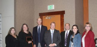 Timberland Bank employees accepting Large Business of the Year award