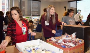 Summit Pacific's Lourdes Schoch and Randi Johnson helped package the meals prior to delivery.