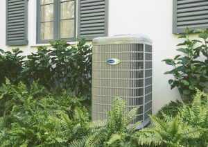 Sunset Air Carrier heat pump outside a home