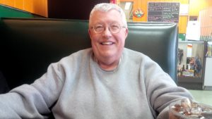 Tom-Brosman-smiling-grey-shirt
